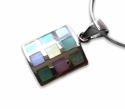 silver pendant with nine squares of mother of pearl