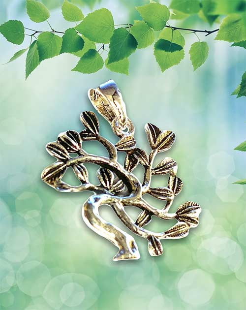 silver pendant of a tree of life