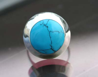 round turquoise stone set on a ring