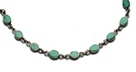 oval green turquoises set in a silver bracelet