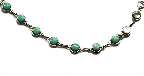 silver bracelet with turquoise and white mother of pearl