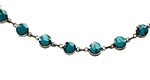 sky blue turquoise set in round silver mounts on a bracelet